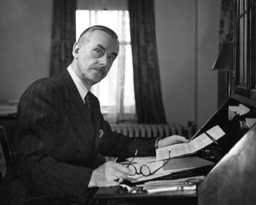 Portrait of German author Thomas Mann (1875 - 1955) as he sits at his desk, a piece of paper in one hand and his glasses in the other, New York, New York, 1943. (Photo by Fred Stein Archive/Archive Photos/Getty Images)